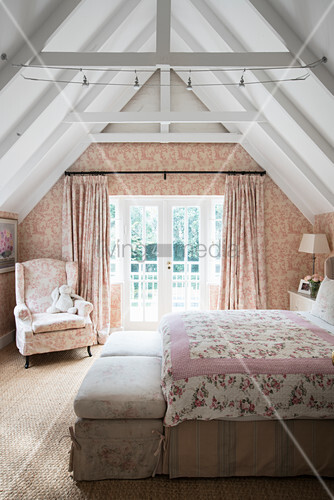 Romantic bedroom with toile de jouy wallpaper and curtains