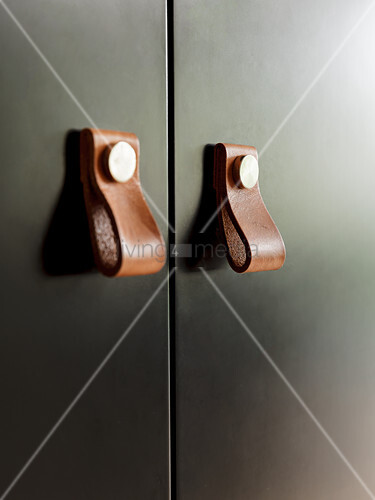Cupboard doors with leather handles