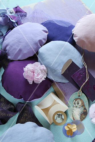 Small round cushions in various shades of purple