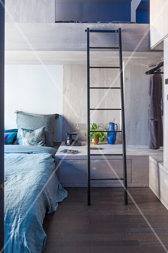 Modern, concrete bunk beds in blue and grey bedroom