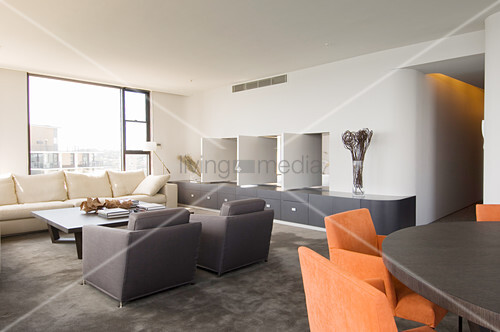 Flexible wall panels between bedroom and living room in modern interior