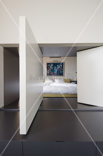 Flexible wall panels between bedroom and living room