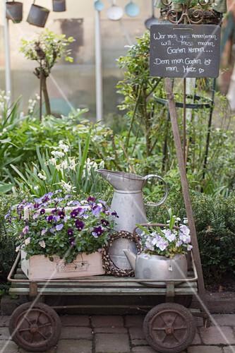 Spring decoration with old kitchen utensils on handcart