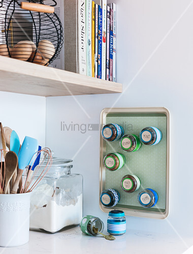 Spice rack made from tiny jars with magnetic lids and baking tray