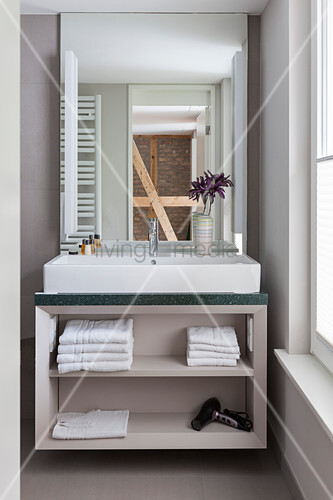 Washstand with countertop sink in bathroom