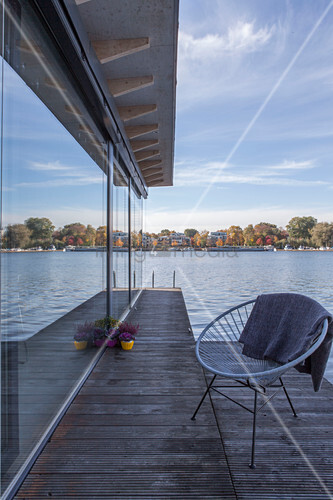 Modern houseboat: chair on deck