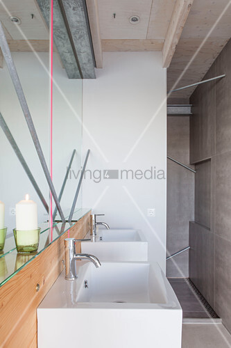 Modern houseboat: simple bathroom with sink and shower area