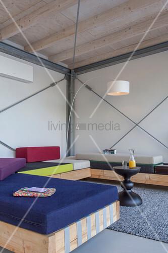 Modern houseboat: custom sofas in living area