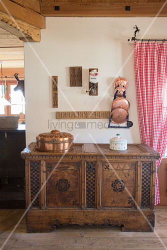 Old wooden trunk in traditional farmhouse parlour