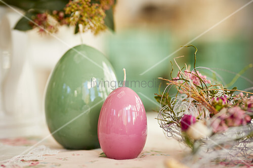 Easter-egg candles decorating table