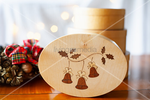 Wooden box with inlaid lid and Christmas decorations