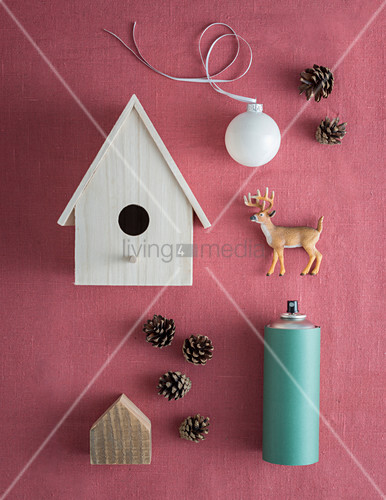 Winter arrangement of nesting box and can of spray paint