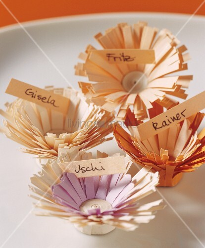 Four place-cards in shape of flowers