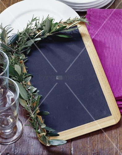 Slate board with herb decoration for writing menu