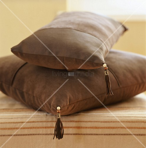 Two brown cushions