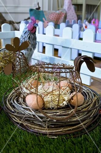 Eggs in hen-shaped basket in Easter nest