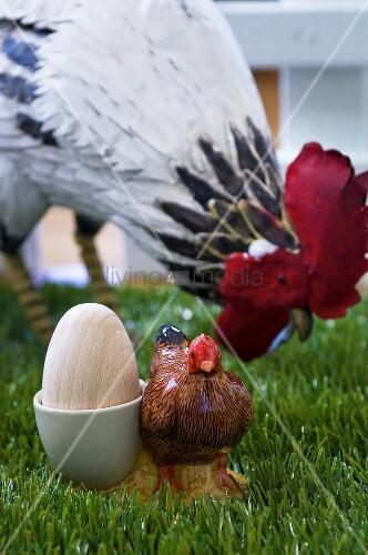 Easter decorations (wooden egg in novelty egg cup, model hen)