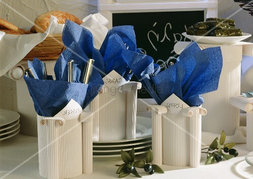 Cutlery holders on a Greek buffet
