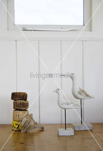Cork floats and wooden seagulls to decorate a room with a nautical theme
