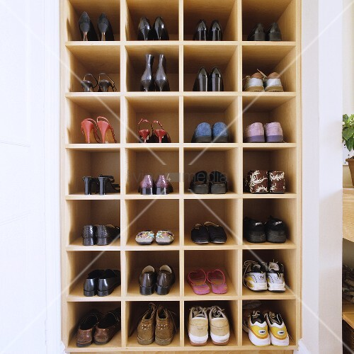 A shoe shelf built into a wall niche
