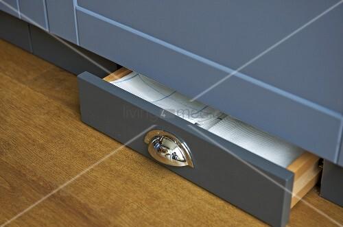 Low drawer at bottom on kitchen unit