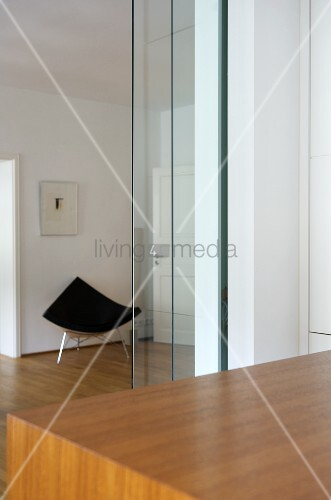Modern chair in corner of open plan room